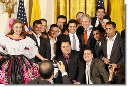 President George W. Bush poses for photos with entertainers Jorge Celedon, Jimmy Zambrano and their performance group during the celebration of Colombian Independence Day Tuesday, July 22, 2008, in the East Room of the White House. White House photo by Eric Draper
