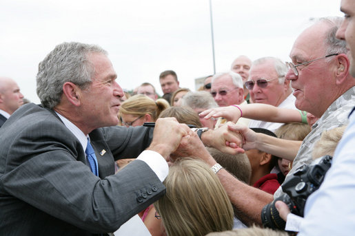 President George Bush greets military personnel and families upon departure from the Greater Peoria Regional Airport - Air National Guard Ramp in Peoria, IL Friday, July 25, 2008. White House photo by Chris Greenberg