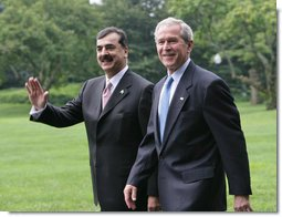 President George W. Bush walks with Pakistani Prime Minister Syed Yousaf Raza Gillani from the Oval Office to deliver their remarks Monday, July 28, 2008, on the South Lawn of the White House. White House photo by Chris Greenberg