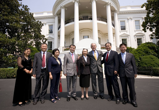 President George W. Bush poses for a photo at the South Portico entrance to the White House Tuesday, July 28, 2008, with Chinese Human Rights Activists, from left, Ciping Huang, Wei Jingsheng, Sasha Gong, Alim Seytoff, interpreter; Rebiya Kadeer, Harry Wu and Bob Fu, following their meeting at the White House. White House photo by Eric Draper