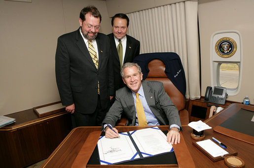 President George W. Bush is joined by Rep. Steven LaTourette, R-OH, left, and Rep. Patrick Tiberi, R-OH, at the signing of S.2766, The Clean Boating Act of 2008, Tuesday, July 29, 2008, aboard Air Force One on the flight from Euclid, Ohio to Washington, D.C. White House photo by Chris Greenberg