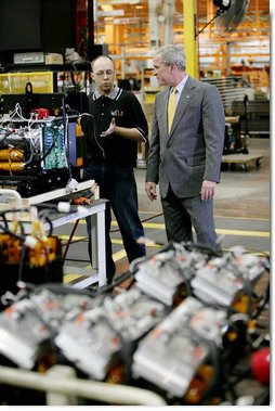 President George W. Bush speaks with a worker during his tour of the Lincoln Electric Company in Euclid, Ohio, on Tuesday, July 29, 2008, where President Bush also addressed remarks on energy and economic issues. White House photo by Chris Greenberg