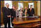 President George W. Bush signs H.J. Res. 93, the Renewal of Import Restrictions on Burma and H.R. 3890, the Tom Lantos Block Burmese JADE Act of 2008, Tuesday, July 29, 2008 in the Oval Office of the White House. President Bush was joined during the signings by, from left, Rep. Don Manzullo, R-Ill.; Rep. Chris Smith, R-N.J.; Mrs. Laura Bush, Annette Lantos, widow of Rep. Tom Lantos; Lantos grandson, Shiloh Tillemann; Rep.Rush Holt, D-N.J.; Rep. Joe Pitts, R-Pa.; and Rep. Peter King, R-N.Y. White House photo by Eric Draper