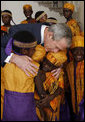 President George W. Bush embraces members of the African Children's Choir Wednesday, July 30, 2008, thanking them for their musical performance at the White House. White House photo by Eric Draper