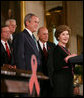 President George W. Bush is introduced to the podium by Mrs. Laura Bush Wednesday, July 30, 2008 in the East Room of the White House, prior to signing H.R. 5501, the Tom Lantos and Henry J. Hyde United States Global Leadership Against HIV/AIDS, Tuberculosis and Malaria Reauthorization Act of 2008. White House photo by Joyce N. Boghosian