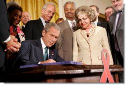 President George W. Bush is joined by Annette Lantos, right, and invited guests Wednesday, July 30, 2008 in the East Room of the White House, as he signs H.R. 5501, the Tom Lantos and Henry J. Hyde United States Global Leadership Against HIV/AIDS, Tuberculosis and Malaria Reauthorization Act of 2008. White House photo by Joyce N. Boghosian