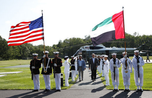 President George W. Bush walks through an honor guard with Sheikh Mohammed bin Rashid al-Maktoum, Prime Minister of the United Arab Emirates and ruler of Dubai, Sunday, Aug. 3, 2008 in Camp David. White House photo by Eric Draper