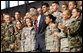 President George W. Bush stands with military personnel on stage Monday, Aug. 4, 2008, after delivering remarks at Eielson Air Force Base during a stop in Alaska en route to South Korea. White House photo by Eric Draper