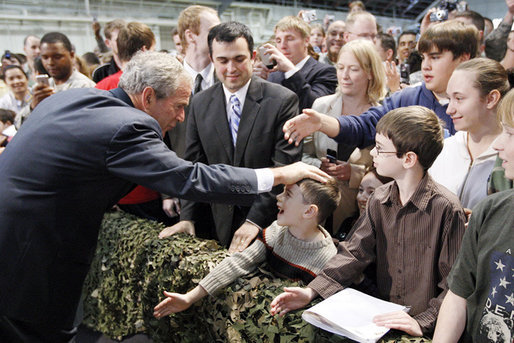 President George W. Bush pats the head of a youngster as he greets the crowd Monday, Aug. 4, 2008, after addressing military personnel at Eielson Air Force Base in Alaska. White House photo by Eric Draper