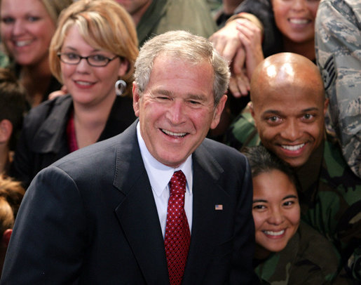 President George W. Bush poses for photos with members of the audience Monday, Aug. 4, 2008, after he delivered remarks to military personnel at Eielson Air Force Base in Alaska. White House photo by Chris Greenberg