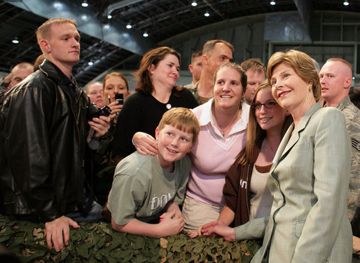 Mrs. Laura Bush joins members of the audience for photos Monday, Aug. 4, 2008, after remarks by President George W. Bush at Eielson Air Force Base, Alaska. White House photo by Shealah Craighead