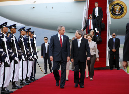 President George W. Bush and Mrs. Laura Bush are welcomed on their arrival Tuesday, Aug. 5, 2008 to Seoul Airbase, outside Seoul, by Korean Minister of Foreign Affairs and Trade Myung-hwan Yu. White House photo by Eric Draper