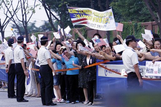 Crowds cheer and wave flags as the motorcade of President George W. Bush and Mrs. Laura Bush passes Tuesday, Aug. 5, 2008, following President Bush's arrival to Seoul. White House photo by Eric Draper