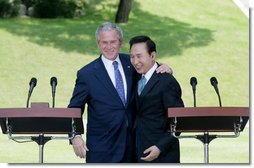 President George W. Bush embraces South Korean President Lee Myung-bak at the conclusion of their joint news conference Wednesday, Aug. 6, 2008, at the Blue House presidential residence in Seoul, South Korea. White House photo by Chris Greenberg