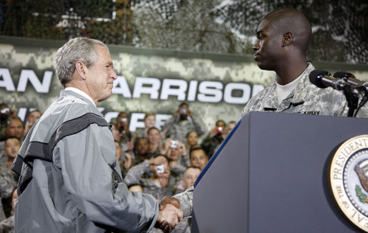 President George W. Bush shakes hands with U.S. Army Cpl. Victor Berlus before delivering his remarks to the U.S. Army Garrison-Yongsan Wednesday, August 6, 2008, in Seoul, South Korea. White House photo by Eric Draper