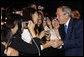 President George W. Bush greets United States Embassy personnel and family members Wednesday, Aug. 6, 2008, in Seoul. White House photo by Eric Draper