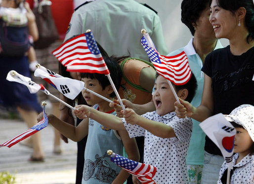 Children wave American and South Korean flags during the visit of President George W. Bush and Mrs. Laura Bush Wednesday, Aug. 6, 2008, to Seoul. White House photo by Eric Draper