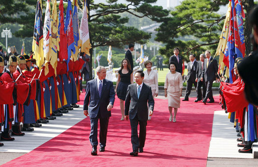 President George W. Bush and South Korean President President Lee Myung-bak, joined by Mrs. Laura Bush, Mrs. Kim Yoon-ok, and daughter Ms. Barbara Bush, participate in a welcoming ceremony in the Grand Garden of the Blue House Wednesday, Aug. 6, 2008, in Seoul. White House photo by Eric Draper