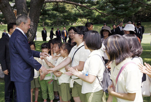 President George W. Bush is joined by South Korean President, Lee Myung-bak, as he greets children during his visit to the Blue House Wednesday, Aug. 6, 2008, in Seoul. White House photo by Eric Draper