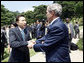President George W. Bush shakes hands with South Korean President Lee Myung-bak before leaving the Blue House Wednesday, Aug. 6, 2008, in Seoul. White House photo by Eric Draper