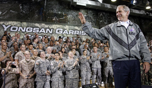 President George W. Bush waves as he is welcomed by U.S. military personnel before delivering his remarks Wednesday, Aug. 6, 2008, at the U.S. Army Garrison-Yongsan in Seoul. White House photo by Eric Draper