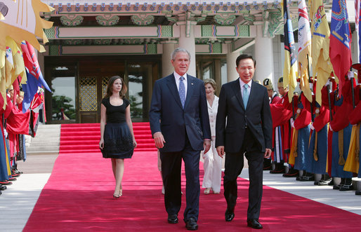 President George W. Bush walks with President Lee Myung-bak of the Republic of Korea, along with Mrs. Laura Bush and Barbara Bush, as they arrive at the Blue House, the presidential residence, Wednesday, Aug. 6, 2008, in Seoul. White House photo by Chris Greenberg