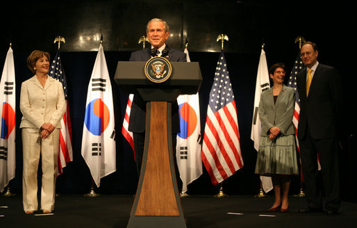 "President George W. Bush and Mrs. Laura Bush receive a warm welcome during their visit Wednesday, Aug. 6, 2008, at the U.S. Embassy in Seoul. With them on stage are U.S. Ambassador to Korea Alexander ""Sandy"" Vershbow and Mrs. Lisa Vershbow. White House photo by Shealah Craighead"