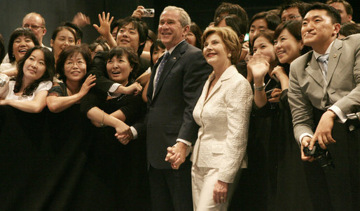 President George W. Bush and Mrs. Laura Bush receive a warm welcome Wednesday, Aug. 6, 2008, during their visit to the U.S. Embassy in Seoul. White House photo by Shealah Craighead