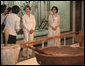 Mrs. Laura Bush visits the National Folk Museum of Korea Wednesday, Aug. 6, 2008, in Seoul. At right is Lee Ki Won, the museum's Deputy Director of Cultural Exchange and Education. White House photo by Shealah Craighead