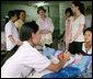 Mrs. Laura Bush and daughter Barbara Bush talk with a nurse Thursday, Aug. 7, 2008 at Mae Tao Clinic at the Mea La Refugee Camp which provides free treatment for the sick and wounded Burmese migrant workers in Mae Sot, Thailand. White House photo by Shealah Craighead