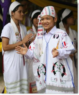 Residents of the Mae La Refugee Camp at Mae Sot, Thailand, perform traditional dance for Mrs. Laura Bush during her visit to the camp on the Burma border on Aug. 7, 2008. It has been almost 20 years since the August 8, 1988 crackdown in Burma which began forcing residents from the country. Many of the people in the Mae La Refugee Camp and the other eight camps along the border have been born in the camps or lived most of their lives in the camps, waiting for conditions to improve in Burma or to move to the United States and other countries. White House photo by Shealah Craighead
