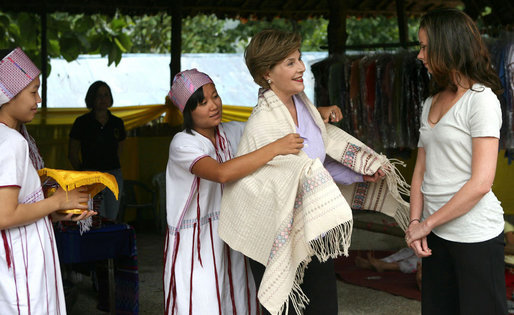 Mrs. Laura Bush and daughter Ms. Barbara Bush examine local wares after a dance ceremony and viewing traditional Karen weaving at the Mae La Refugee Camp at Mae Sot, Thailand, on Aug. 7, 2008. Mrs. Bush's visit to one of the largest refugee camps on the border was at the top of a mountain on the border with Burma. In her comments, Mrs. Bush noted the generosity of the Thai government and the people of Thailand in allowing the nine camps to exist there. White House photo by Shealah Craighead