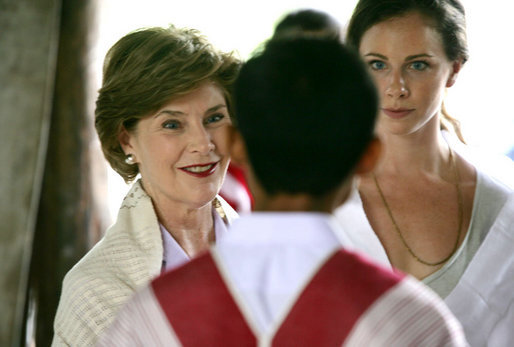 Mrs. Laura Bush and daughter Ms. Barbara Bush, right, visit a grammar class at the Mae La Refugee Camp at Mae Sot, Thailand, on August 7, 2008. At least 39,000 Burmese have gathered at this camp to escape oppression in their country. The camp is the largest of nine refugee camps in Thailand. White House photo by Shealah Craighead