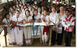 During her visit to the Mae La Refugee Camp in Mae Sot, Thailand, Mrs. Laura Bush visits with a class studying grammar. Mrs. Bush's daughter, Ms. Barbara Bush is to the right of Mrs. Bush in the Aug. 7, 2008 visit. The camp, the largest of nine on the border, houses at least 39,000 refugees fleeing the oppression in Burma. White House photo by Shealah Craighead