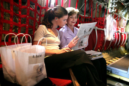 Mrs. Laura Bush and her daughter Ms. Barbara Bush go over information on the plane as they fly to Thailand on Aug. 7, 2008. The visit highlighted the problems facing the Burmese refugees living inside the Thailand border in nine refugee camps. It has been 20 years since the Aug. 8, 1988 crackdown in Burma. Since 2005 alone, a little over 30,000 Burmese have moved to the United States to find a home and escape the dire conditions. White House photo by Shealah Craighead