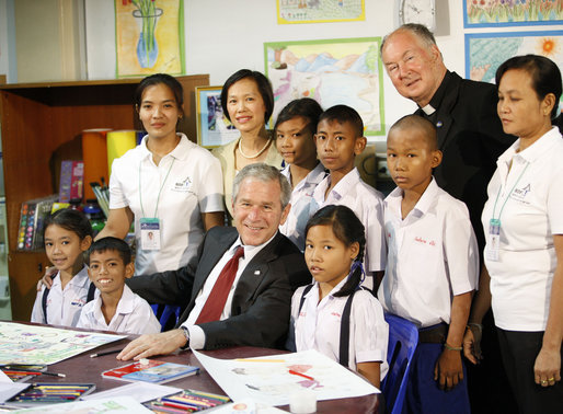 President George W. Bush poses for a photo with children and staff members, including Father Joseph Maier, during his visit Thursday, Aug. 7, 2008, to the Human Development Foundation-Mercy Centre, a non-profit organization to help educate and improve the health and welfare of poor children in Bangkok. White House photo by Eric Draper