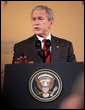 President George W. Bush gestures as he delivers remarks at the Queen Sirikit National Convention Center Thursday, August 7, 2008, in the Bangkok. White House photo by Chris Greenberg