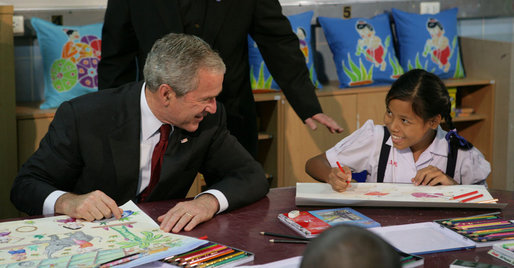 President George W. Bush visits with children on August 7, 2008, in Bangkok at the Human Development Foundation - Mercy Centre, a non-profit organization which helps the children and communities of the many slums of Bangkok. The group builds and operates schools, works on issues concerning family health and welfare – such as protecting street children's rights and combating AIDS. The President followed the event by dealing with the issues of Burmese disaster relief and meeting with Burmese activists and media before heading to China. White House photo by Chris Greenberg