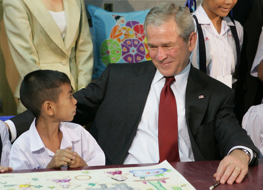 President George W. Bush visits with children on August 7, 2008, in Bangkok at the Human Development Foundation - Mercy Centre, a non-profit organization which helps the children and communities in the slums of Bangkok. The group builds and operates schools, works on issues concerning family health and welfare. The President followed the event by dealing with the issues of Burmese disaster relief and meeting with Burmese activists and media before heading to China. White House photo by Chris Greenberg