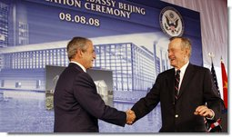 President George W. Bush is welcomed to the podium after an introduction by former President George H.W. Bush Friday, Aug. 8, 2008, at the dedication for the U.S. Embassy in Beijing. White House photo by Eric Draper