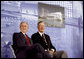 President George W. Bush and former President George H.W. Bush sit on stage at the U.S. Embassy in Beijing Friday, Aug. 8, 2008, during dedication ceremonies. Both are scheduled to attend opening ceremonies scheduled for later in the evening. White House photo by Eric Draper