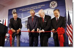 President George W. Bush and former President George H.W. Bush join U.S. Ambassador to China Sandy Randt and Dai Bingguo, People's Republic of China State Councilor, as they participate in a ribbon-cutting ceremony Friday, Aug. 8, 2008, at the U.S. Embassy in Beijing. White House photo by Eric Draper