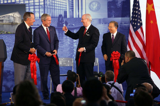 U.S. Ambassador to China Sandy Randt gives a thumbs-up to President George W. Bush and former President George H.W. Bush after they cut the ceremonial ribbon during a dedication Friday, Aug. 8, 2008, for the U.S. Embassy in Beijing. At right is Dai Bingguo, State Councilor, People's Republic of China. White House photo by Shealah Craighead
