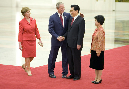President George W. Bush and Mrs. Laura Bush are greeted by Chinese President Hu Jintao and Madam Liu Yongqing at the Great Hall of the People in Beijing Friday, Aug. 8, 2008, for the social lunch in honor of the 2008 Summer Olympic Games. White House photo by Eric Draper