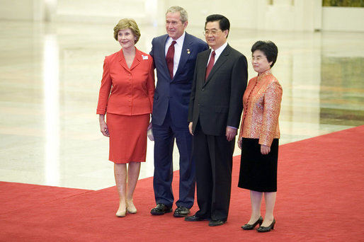 President George W. Bush and Mrs. Laura Bush participate in a photo opportunity with President Hu Jintao of the People's Republic of China and Madam Liu Yongqing at the social luncheon in honor of the 2008 Summer Olympic Games in Beijing. The luncheon was held at the Great Hall of the People. White House photo by Eric Draper
