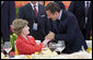 Mrs. Laura Bush is greeted by France President Nicolas Sarkozy during a social luncheon Friday, Aug. 8, 2008, at the Great Hall of the People in Beijing in honor of the 2008 Summer Olympic Games. White House photo by Eric Draper