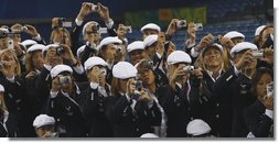 United States Olympians take photos of President George W. Bush as he speaks to the athletes Friday, Aug. 8, 2008, prior to the start of the Opening Ceremony for the 2008 Summer Olympic Games in Beijing. White House photo by Eric Draper