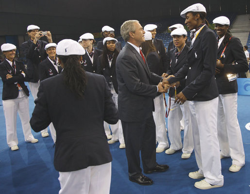 President George W. Bush meets with members of the women's U.S. Olympic Basketball Team Friday evening, Aug. 8, 2008 at the National Stadium in Beijing, prior to the U.S. Olympians marching in the Opening Ceremonies at the 2008 Summer Olympics. White House photo by Eric Draper