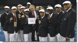 President George W. Bush poses for photos with members of the United States Olympic Boxing Team Friday, Aug. 8, 2008, before the Opening Ceremony of the 2008 Summer Olympic Games in Beijing. White House photo by Eric Draper