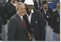 President George W. Bush stands with Danielle Scott-Arruda, a member of the U.S. Olympic Volleyball team, as he meets with the athletes Friday, Aug. 8, 2008, prior to the start of the Opening Ceremony of the 2008 Summer Olympic Games in Beijing. White House photo by Eric Draper